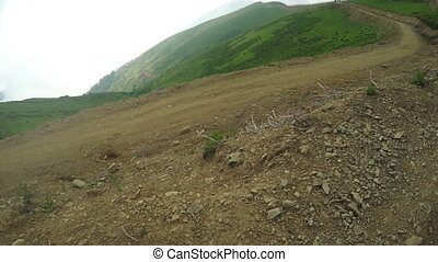 Road with stones in mountains - Camera moves on steadicam on...