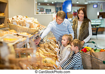 Family and children - Smiling family in bakery