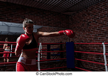 Boxing - Attractive woman in boxing gloves