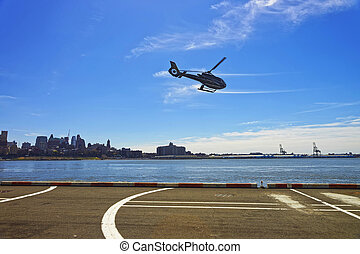 Black Helicopter over helipad in Lower Manhattan - New York,...