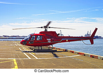 Red Helicopter on helipad in Lower Manhattan in New York -...
