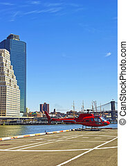 Red Helicopter landing on helipad in Lower Manhattan New...
