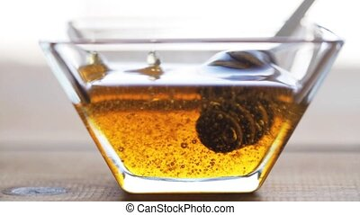 honey in glass bowl and dipper - healthy food, eating,...