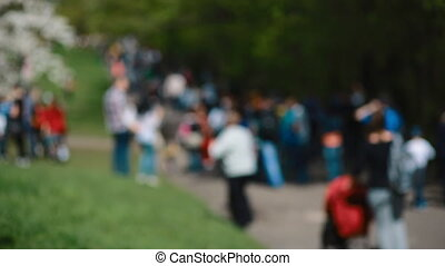 People walk in the park on sunny day