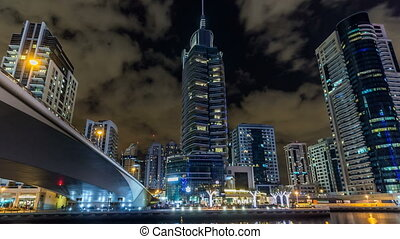 View of Dubai Marina Towers and canal in Dubai night...