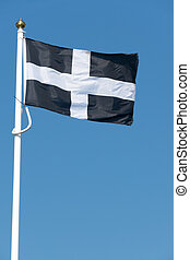 Cornish flag of St. Piran blowing in the wind.