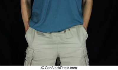 Man Turns the Empty Pockets of His Shorts. No Money. Man...