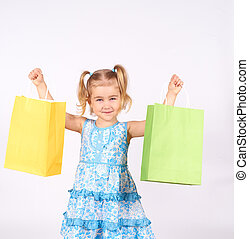 Shopping child. little girl holding shopping bags.