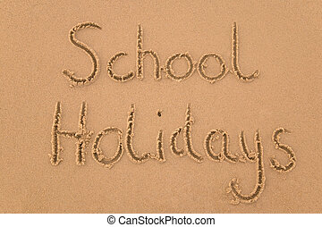 School holidays in sand - School Holidays handwritten in...
