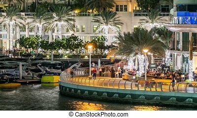 Promenade in Dubai Marina timelapse at night, UAE.