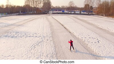 A man skiing at empty stadium - A young man in tracksuit...
