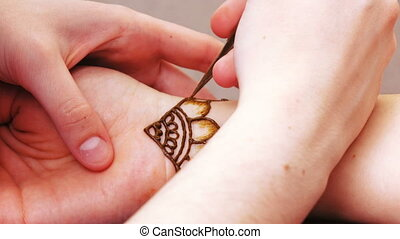 Drawing henna mehendi - On hand drawing mehendi applied to...