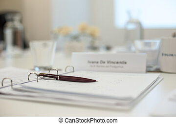 Business work place with pen and papers on the table