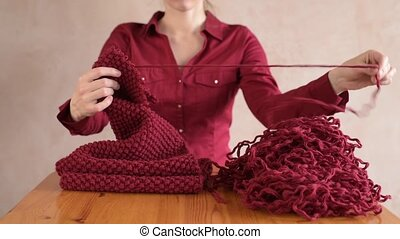 Girl unravelling the red scarf. HD
