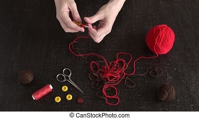 Female hands begin crocheting HD