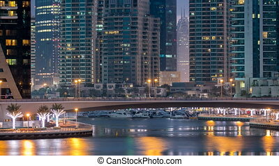 View of Dubai Marina Towers and canal in Dubai night to day...