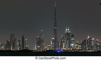 Skyline of Downtown Dubai at night timelapse. Burj Khalifa,...