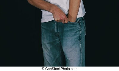 Man Turns the Empty Pockets of His Jeans. No Money. Man...