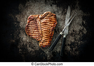 Grilled T-Bone Steak on dark background