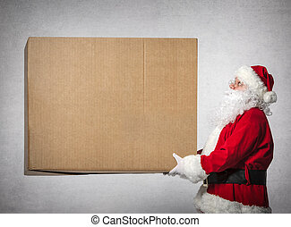 Santa Claus holds big gift box - Santa Claus holds a big...
