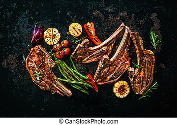 Roasted lamb meat with vegetables on dark background