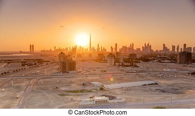 Sunset with skyline of Downtown Dubai in the evening timelapse.