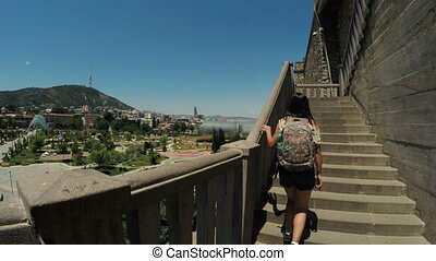 climbing stairs - Camera follows girl climbing on stairs in...