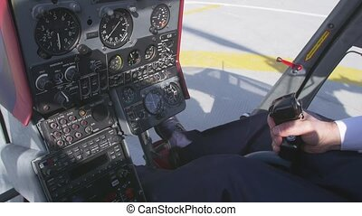 View at pilot take control handle to take off on helicopter...