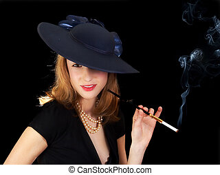 Smoking in style - Young smiling woman in black, smoking a...