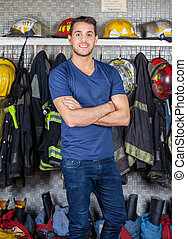 Smiling Firefighter Standing At Fire Station - Portrait of...