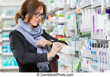 Female Customer Scanning Product Through Smartwatch In Pharmacy