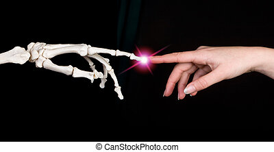 Touching fingers - Hands of a woman touching the hand of a...