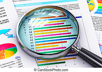 Financial report documents and magnifying glass