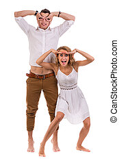 Surprised young couple on white background, isolated -...