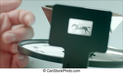 A hand twisting cinematograph - Clip of hand setting...