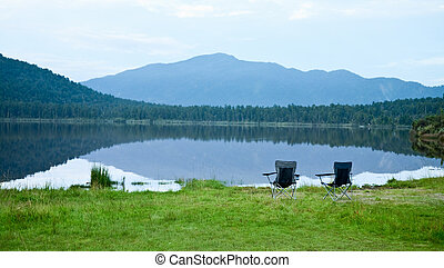 Chairs by lake - Two foldable camping chair on a mountain...
