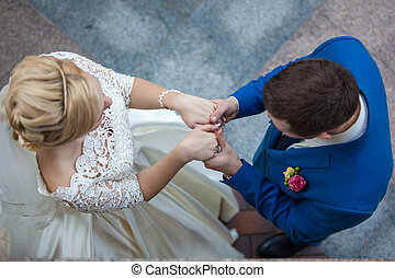 Wedding Ceremony - Wedding couple holding hands during the...