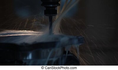 CNC machine drilling process closeup
