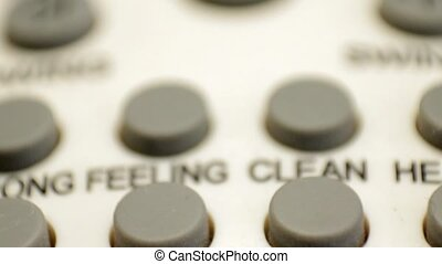 macro of an air conditioner remote control - macro of an old...