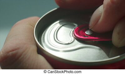 Opening of fizzy drink can - Slow motion clip of a person...