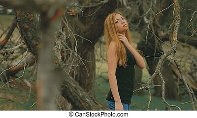 sexy girl in dense forest old dry branches slow motion...