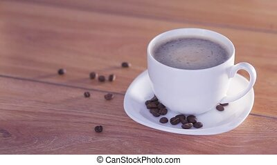 Delicious and hot white cup of coffee with beans, HD 1080