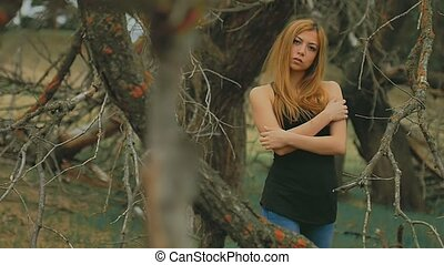 sexy girl in dense forest old dry branches outdoors slow...
