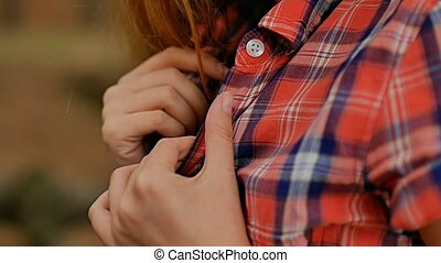 sexy girl holding hands by the collar plaid shirt slow motion