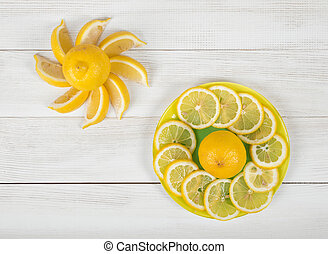 Flat lay of citrus fruit slices laid out on a saucer. Top...