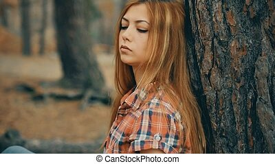 Sexy girl in plaid shirt in the forest pine slow motion -...