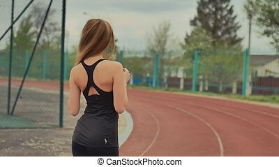 girl on a touching hair for sports slow motion - girl on a...