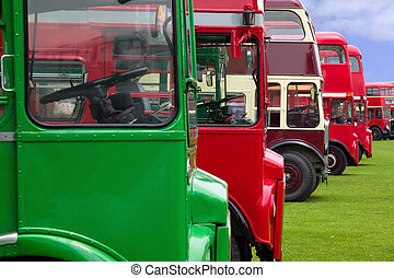 Old London buses - Vintage double decker buses in a row.