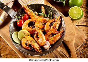 Delicious spicy grilled prawns with trimmings including...