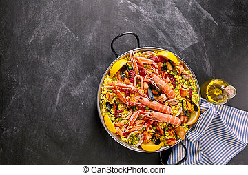 Spanish Seafood Paella Dish on Chalkboard Surface - High...